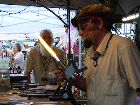 Fair Glass Blower Holding Blow Torch | Glass Blowing - Daily Entertainment