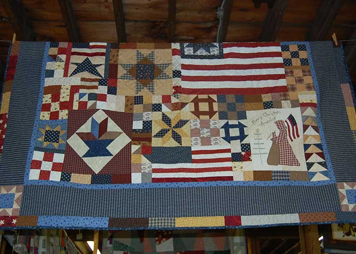 Quilt with American Fags and Geometric Shapes | Arts & Crafts Exhibits