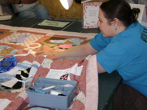 Woman Hand Sewing a Quilt | Quilting - Daily Entertainment