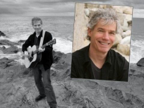 Peter Mundt Holding a Guitar